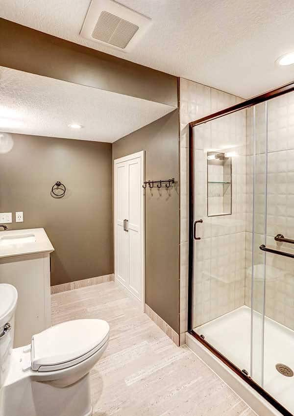 Remodeled bath by Titus Contracting includes linen area with towel hook
