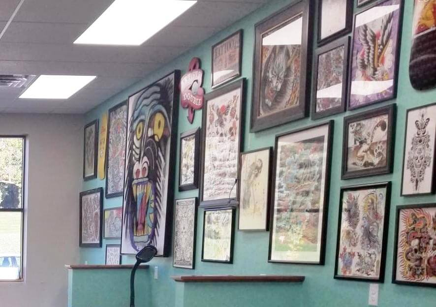 Burnsville MN Aloha Monkey commercial renovation results in creative wall of tattoo art