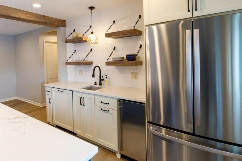 This basement kitchenette takes advantage of every inch with fridge, sink, dishwasher, and plenty of space to entertain
