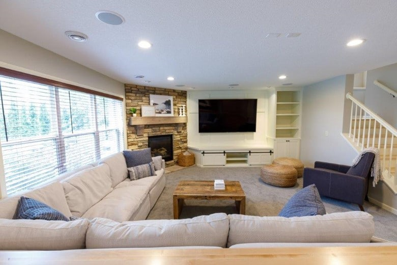 For this Minneapolis lower-level upgrade, our design team mixed custom solutions with low-cost design tricks for an elevated basement family room.
